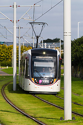 Tram travels through Edinburgh Park a modern business park at South Gyle in Edinburgh, Scotland, United Kingdom.