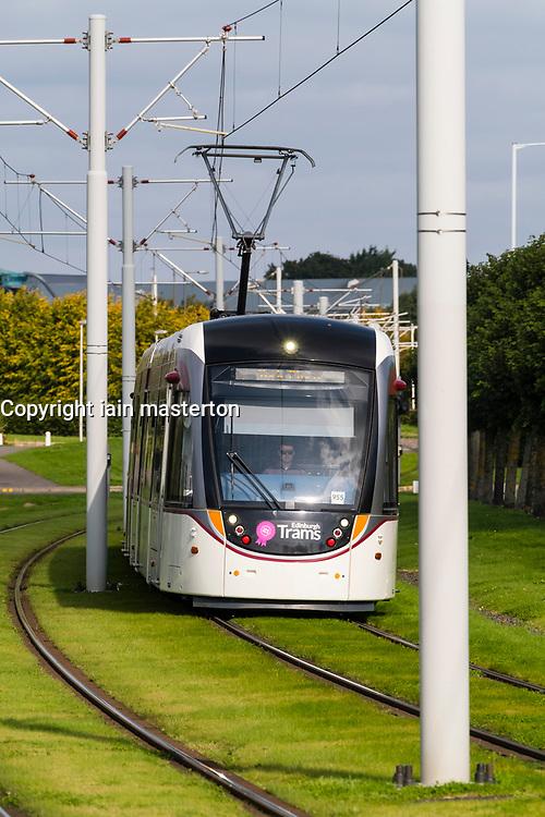 Tram travels through Edinburgh Park a modern business park at South Gyle in Edinburgh, Scotland, United Kingdom.