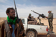 Mcc0030300 . Daily Telegraph..Rebel fighters on the road to Brega about 50kms from Ajdabiyah. Brega is still in the control of Gaddafi's army but the rebels appear to be better organised today and gaining ground with reports of fighting around the University...Brega 1 April 2011