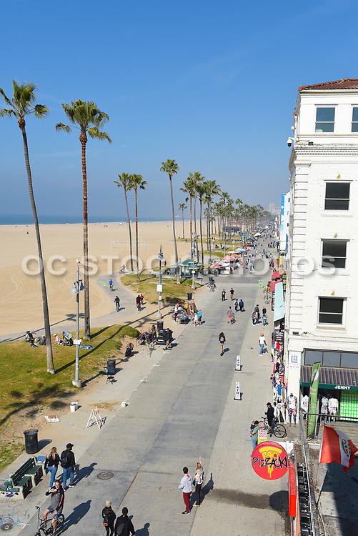 Tourists on Venice Beach Boardwalk Looking North Towards Santa Monica