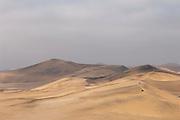 Quad bikes driving over dunes in the Namib Desert near Swakopmund, Namibia