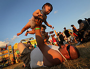 Nick Myslinski plays with his daughters Makaila, 8 months (top cq), and Madison, 2, while waiting for the fireworks show Tuesday, July 3, 2012 at Ribfest in Naperville. (Brian Cassella/Chicago Tribune)  B582214580Z.1<br /> ....OUTSIDE TRIBUNE CO.- NO MAGS,  NO SALES, NO INTERNET, NO TV, CHICAGO OUT, NO DIGITAL MANIPULATION...