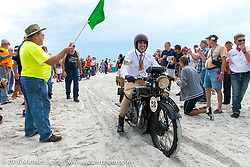 Kevin Waters riding his 1931 Sunbeam M9 Antique passes through the start on the sands of Daytona Beach at the beginning of stage 1 of the Motorcycle Cannonball Cross-Country Endurance Run, which on this day ran from Daytona Beach to Lake City, FL., USA. Friday, September 5, 2014.  Photography ©2014 Michael Lichter.