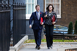 © Licensed to London News Pictures. 29/10/2018. London, UK. Secretary of State for Business, Energy and Industrial Strategy Greg Clark (L) and Minister of State at Department for Business, Energy and Industrial Strategy Claire Perry (R) arrive on Downing Street for a Cabinet meeting before Chancellor of the Exchequer Philip Hammond delivers the budget. Photo credit: Rob Pinney/LNP