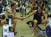 2004_British_Indoor_Rowing_Championships.NIA. Birmingham.England. 21.11.2004.MBUSA Hwt  Varsity Presidents race on adjacent Machines Andrew Shannon [left light Blue] shakes hands with Robin Bourne-Taylor [ dark Blue] after the race..[Mandatory Credit Peter Spurrier/ Intersport Images]