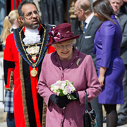© London News Pictures. 30/04/2012. London, UK. HRH The Queen Elizabeth II with Mayor of Windsor Asghar Majeedon (left) on a walk from Windsor Castle to the Guildhall, Windsor, Berkshire on April 30, 2012, where she attended a Diamond Jubilee reception. Photo credit : Ben Cawthra /LNP
