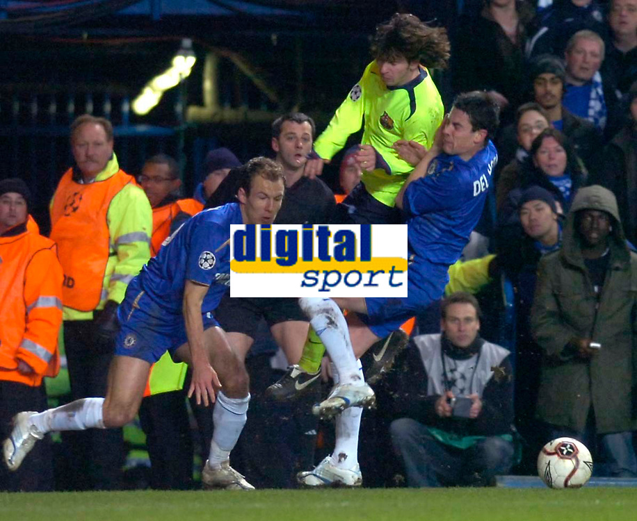 Photo: Alan Crowhurst.<br />Chelsea v Barcelona. UEFA Champions League. 22/02/2006.<br />Chelsea's Asier Del Horno (R) makes the challenge that earns him the red card.