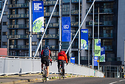 Glasgow, Scotland, UK. 21st October 2021. Final preparations underway at the site of the UN Climate Change Conference COP26 to be held in Glasgow from Oct 31st. Pic; Banners advertising COP26. Iain Masterton/Alamy Live News.
