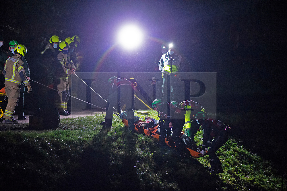 CAPTION UPDATE © Licensed to London News Pictures 19/01/2021. Orpington, UK. The casualty is pulled up the river bank in a rescue stretcher. A woman was rescued from the River Cray in Orpington, South East London last night (19.01.21) after being attacked by a man. Reports on social media say the woman was stuck in muddy freezing river water. The London Ambulance Hazardous Area Response Team along with firefighters from the London Fire Brigade used specialist equipment to free the woman. She was taken to hospital and is in a non life threatening condition. A man has been arrested. Photo credit:Grant Falvey/LNP