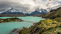 The Hosteria Pehoe is positioned on a small island on lake Pehoe and has stunning views of the mountain range - Torres del Paine National Park, Chile.