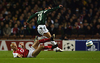 Photo. Daniel Hambury, Digitalsport<br /> UEFA Champions league.<br /> Arsenal v Panathinaikos. 2/11/2004.<br /> Arsenal's Cygan and Panathinaikos' Papadopoulos