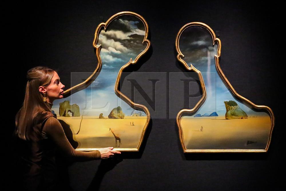 © Licensed to London News Pictures. 29/01/2020. London, UK. A staff member holds Salvador Dalí, Couple aux têtes de pleins nuages (1937) (est £7m to £10m) at the preview of Bonhams Impressionist and Modern Art Sale. Photo credit: Dinendra Haria/LNP