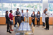 Purchase, NY – 31 October 2014. . The Valhalla High School  practicing their presentation. From left to right: , Jenna Goldberg, Jorolyn Gardner, Michael Nduka, Tyler Wills, Alec Uy, Jessica Tesoro, Daniela Espinosa, and Gabrielle Orr. The Business Skills Olympics was founded by the African American Men of Westchester, is sponsored and facilitated by Morgan Stanley, and is open to high school teams in Westchester County.