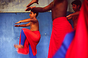 Boys at a dance class at the Kerala Kalamandalam, Kerala, India<br /> The Kalamandalam was founded in 1930 to preserve the cultural traditions of Kathakali, the stylised dance drama of Kerala. Kathakali is the classical dance-drama of Kerala, South India, which dates from the 17th century and is rooted in Hindu mythology. Kathakali is a unique combination of literature, music, painting, acting and dance performed by actors wearing extensive make up and elaborate costume who perform plays which retell in dance form stories from the Hindu epics.