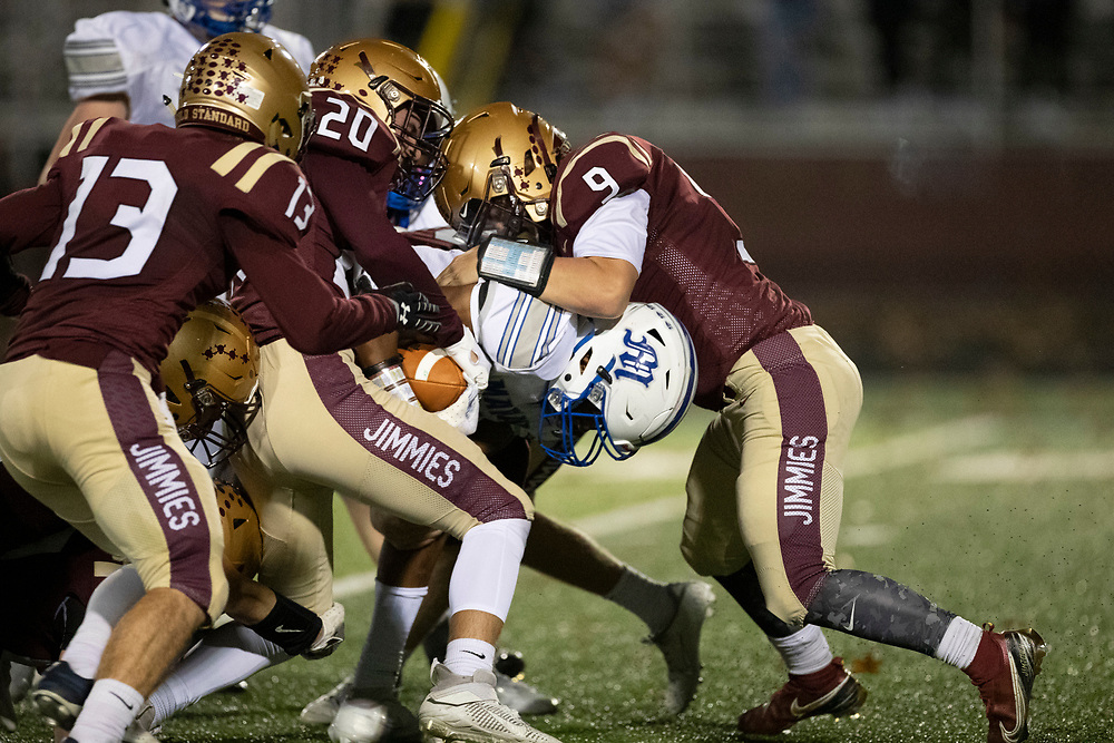 Jimtown defenders make the tackle on Marian's Greg Atkinson during the Marian-Jimtown high school football game on Friday, November 06, 2020, at Knepp Field in Elkhart, Indiana.