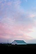 Sunset colors paint the last clouds of a spring storm passing over the Salinas Valley in California