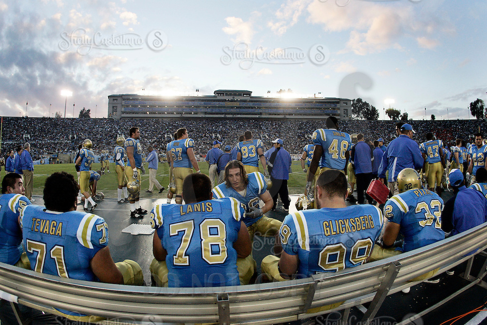 11 November 2006:  #96 Nikola Dragovic and the defensive line on the bench at sunset during the UCLA Bruins 25-7 win over the Oregon State Beavers Pac-10 college football game at the Rose Bowl.<br />
