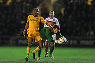 Newport's Chris Zebroski puts pressure on Fleetwood keeper Chris Maxwell. Skybet football league 2 match, Newport county v Fleetwood Town at Rodney Parade in Newport, South Wales on Tuesday 4th March 2014.<br /> pic by Andrew Orchard, Andrew Orchard sports photography.