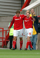 Photo: Leigh Quinnell.<br /> Nottingham Forest v Brighton & Hove Albion. Coca Cola League 1. 19/08/2006. Nottingham Forests Neil Harris(R) helps Grant Holt celebrate his goal.