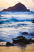 """Sunrise at Koki Beach in the town of Hana in Hawaii's Maui island<br /> ..... <br /> The island of Maui is the second-largest of the Hawaiian Islands and is the 17th largest island in the United States. Maui is part of the State of Hawaii and is the largest of Maui County's four islands, bigger than Molokaʻi, Lānaʻi, and unpopulated Kahoʻolawe. Wailuku is the seat of Maui County and is the third-largest CDP as of 2010. Other significant places include Kīhei (including Wailea and Makena in the Kihei Town CDP, which is the second-most-populated CDP in Maui); Lahaina (including Kāʻanapali and Kapalua in the Lahaina Town CDP); Makawao; Pāʻia; Kula; Haʻikū; and Hāna. Native Hawaiian tradition gives the origin of the island's name in the legend of Hawaiʻiloa, the navigator credited with discovery of the Hawaiian Islands. According to that legend, Hawaiʻiloa named the island of Maui after his son, who in turn was named for the demigod Māui. The earlier name of Maui was ʻIhikapalaumaewa. The Island of Maui is also called the """"Valley Isle"""" for the large isthmus between its northwestern and southeastern volcanoes and the numerous large valleys carved into both mountains."""