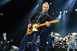 © Licensed to London News Pictures. 17/03/2015. London, UK.   Spandau Ballet performing live at The O2 Arena.   In this picture - Gary Kemp (centre), Martin Kemp (left), Tony Hadley (right). Spandau Ballet are a British new wave band formed in London in the late 1970s, composed of members Tony Hadley (lead vocals, synthesisers), Gary Kemp ( guitar, keyboards, backing vocals), Steve Norman (saxophone, guitar, percussion), John Keeble –(drums, backing vocals), <br /> Martin Kemp (bass).  Photo credit : Richard Isaac/LNP
