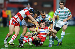 Gloucester Winger (#11) Shane Monahan is tackled by London Irish Winger (#14) Jonathan Joseph during the first half of the match - Photo mandatory by-line: Rogan Thomson/JMP - Tel: Mobile: 07966 386802 05/01/2013 - SPORT - RUGBY - Kingsholm Stadium - Gloucester. Gloucester Rugby v London Irish - Aviva Premiership.