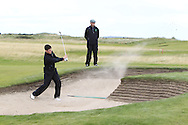 Gary Hurley plays out of a bunker on the 2nd watched on by Tony Goode with the GUI National panel players who are taking part in the Walker cup next week practicing with Neil Manchip and Tony Goode at Portmarnock on Wednesday 2nd September 2015.<br /> Picture:  Thos Caffrey / www.golffile.ie