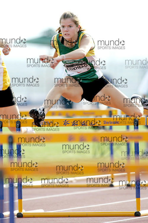 (Sherbrooke, Canada---21 July 2006) Emily Coxhead competing in the qualifying rounds of the 100m hurdles at the 2006 Canadian Junior Track and Field Championships 21-23 July 2006 held in Sherbrooke Quebec. Additional information can be found www.athletics.ca Copyright 2006 Sean Burges / Mundo Sport Images, www.mundosportimages.com