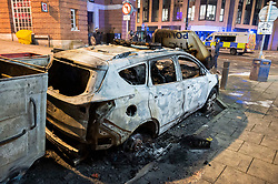"""© Licensed to London News Pictures;22/03/2021; Bristol, UK. A police car is seen burnt out after a police van was set on fire as police clashed with protesters outside Bridewell Police Station on Sunday evening during a """"Kill the Bill"""" protest against the Police, Crime, Sentencing and Courts Bill. The Police, Crime, Sentencing and Courts Bill proposes new restrictions on protests. Photo credit: Simon Chapman/LNP."""