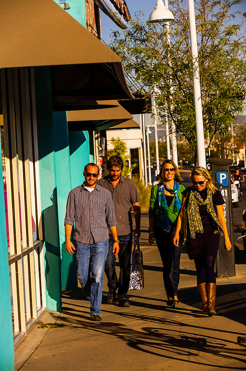 Friends walking by shops in Nob Hill on Central Avenue (Historic Route 66), Albuquerque, New Mexico USA