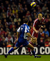 Photo: Jed Wee.<br />Liverpool v Reading. The Barclays Premiership. 04/11/2006.<br /><br />Liverpool's John Arne Riise heads clear.