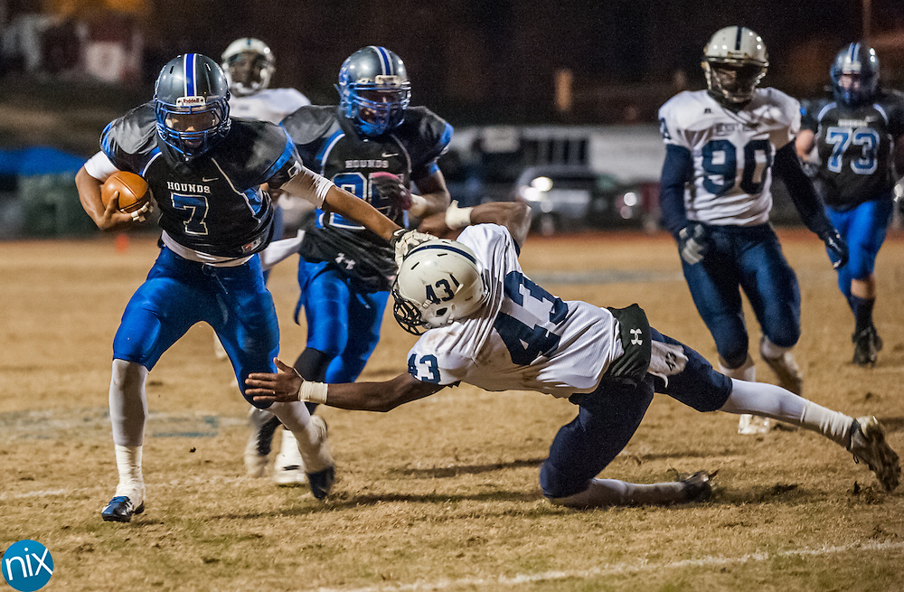 Statesville's Travis Ramseur (7) evades Hickory Ridge's Ethan Jones (43) Friday night during the second round of the NCHSAA Playoffs. Statesville won the game 39-30.
