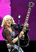 "International recording artist Madonna jams on a guitar during a performance at the National Car Rental Center in Sunrise, Florida, August 14, 2001 The ""Material Girl"" added an additional show of her Drowned World Tour in the Miami area to accomodate her fans. Both shows have been sold out for several months. Stock/Colin Braley"