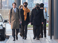 © Licensed to London News Pictures; 25/01/2021; Bristol, UK. Colston Four at court. RHIAN GRAHAM (second left at rear), SAGE WILLOUGHBY (3rd from left  in dark coat) and JAKE SKUSE (right in light jacket) arrive at Bristol magistrates court. Defendants Rhian Graham, 29, Milo Ponsford, 25, Jake Skuse, 32, and Sage Willoughby, 21, are due before Bristol Magistrates' Court for their first hearing today. They have been charged with criminal damage in connection with damage to the statue of slave trader Edward Colston which was pulled down during a Black Lives Matter protest on June 7 2020 and then thrown into Bristol Harbour. Police launched an appeal to trace suspects after the event and ten people were located. Six people accepted a caution while four were referred to the CPS. The statue was later retrieved by Bristol City Council who say that the damage is costed at £3,750. Police have warned anyone planning to protest at the court hearing that they will be breaking the lockdown laws which prohibit public gatherings of more than two people to combat the Covid-19 coronavirus pandemic. Photo credit: Simon Chapman/LNP.