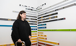 Brazilian artist Jac Leirner (born 1961) presents her first solo exhibition in Scotland, combining work from major collections with new work made especially for the Fruitmarket.<br /> <br /> The exhibition runs from 1 July - 22 October 2017 at the Fruitmarket Gallery in Edinburgh.<br /> <br /> Pictured: Leveled Spirit, 2017 with the artist Jac Leirner