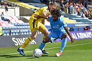 Coventry City defender Junior Brown (12) battles for the ball with Oxford United striker Jamie Mackie (19) during the EFL Sky Bet League 1 match between Oxford United and Coventry City at the Kassam Stadium, Oxford, England on 9 September 2018.