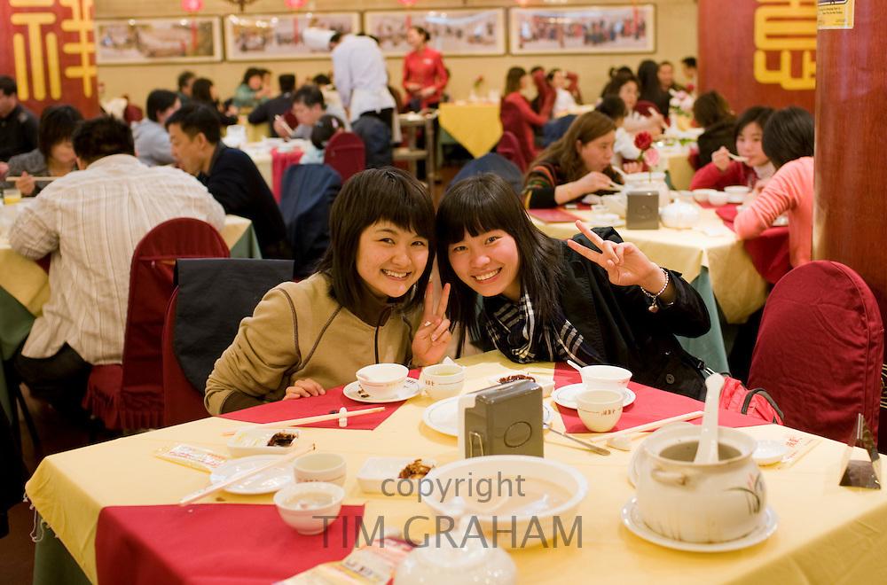 Two girls in Quanjude Roast Duck restaurant, Wangfujing Street, Beijing, China