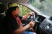 Chief Almir Narayamogo drives his 4x4 four wheel drive through the rainforest interior of the Surui territory<br /><br />An Amazonian tribal chief Almir Narayamogo, leader of 1350 Surui Indians in Rondônia, near Cacaol, Brazil, with a $100,000 bounty on his head, is fighting for the survival of his people and their forest, and using the world's modern hi-tech tools; computers, smartphones, Google Earth and digital forestry surveillance. So far their fight has been very effective, leading to a most promising and novel result. In 2013, Almir Narayamogo, led his people to be the first and unique indigenous tribe in the world to manage their own REDD+ carbon project and sell carbon credits to the industrial world. By marketing the CO2 capacity of 250 000 hectares of their virgin forest, the forty year old Surui, has ensured the preservation, as well as a future of his community. <br /><br />In 2009, the four clans and 25 Surui villages voted in favour of a total moratorium on logging and the carbon credits project. <br /><br />They still face deforestation problems, such as illegal logging, and gold mining which causes pollution of their river systems