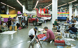 Crews setting up Floats backstage for the Mardi Gras Parade at the Grateful Dead Oakland Coliseum Concert 25 February 1995.