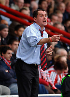 Photo: Daniel Hambury.<br />Brentford v Doncaster Rovers. Coca Cola League 1. 25/03/2006.<br />Brentford's manager Martin Allen shouting from the sidelines.