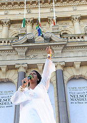 International artist VICKY SAMPSON, sings to the crowd of mourners. The City of Cape Town hosted an interfaith service on the Grand Parade as the day was declared a national day of prayer and reflection on the life of Nelson Mandela. Visitors also placed flowers and condolence messages on the barricade erected to accommodate it. Various religious leaders said prayers for the late South African President, Cape Town, South Africa, Sunday, 8th December 2013. Picture by Roger Sedres / i-Images