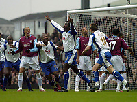 Photo: Olly Greenwood.<br />West Ham United v Portsmouth. The Barclays Premiership. 26/12/2006. Portsmouth's Linvoy Primus celebrates scoring his 2nd goal while the West Ham players look dejected