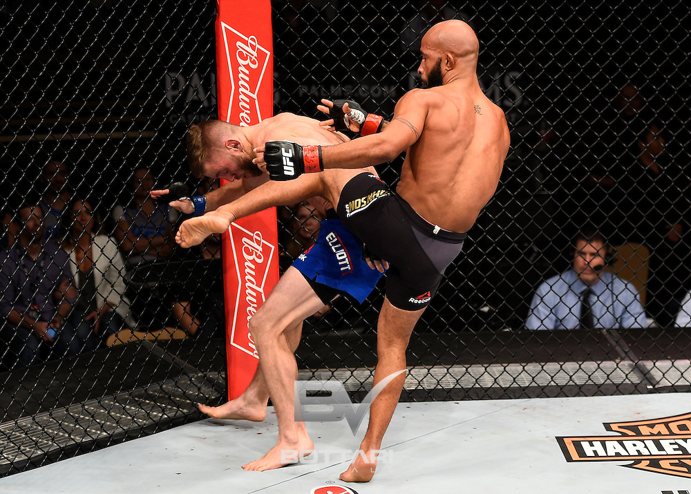 LAS VEGAS, NV - DECEMBER 03:  (R-L) Demetrious Johnson kicks Timothy Elliott in their flyweight championship bout during The Ultimate Fighter Finale event inside the Pearl concert theater at the Palms Resort & Casino on December 3, 2016 in Las Vegas, Nevada. (Photo by Jeff Bottari/Zuffa LLC/Zuffa LLC via Getty Images)