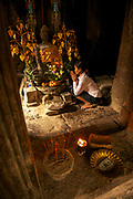 A Cambodian lady makes a pilgrimage to the Bayon, Angkor Thom.