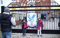 Young Crystal palace fans pose for a photo outside the stadium prior to the Premier League match at Selhurst Park, London.
