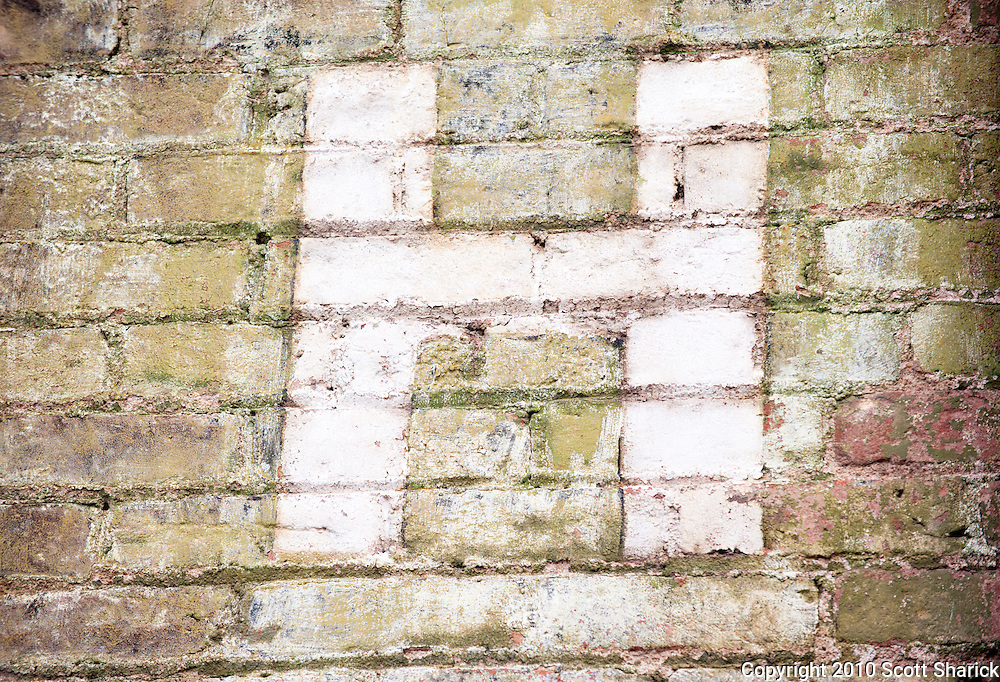The letter 'H' painted on a deteriorating brick wall. Missoula Photographer