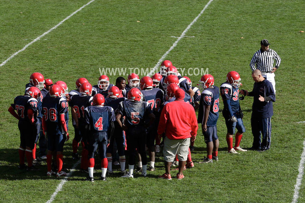 Peekskill, NY - Peekskill High School football players and coaches form a circle and  to prepare for thestart of the  second half of a game in Peekskill on Oct. 18, 2008.