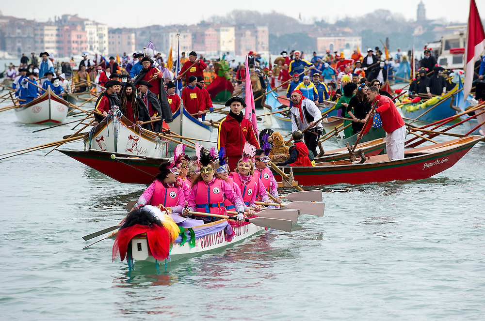 VENICE, ITALY - FEBRUARY 16:  Rowers dresses with  costumes take part in the traditional regatta pn the Grand Canal which officially opens the Carnival  on February 16, 2014 in Venice, Italy. The 2014 Carnival of Venice will run from February 15 to March 4 and includes a program of gala dinners, parades, dances, masked balls and music events.  (Photo by Marco Secchi/Getty Images)