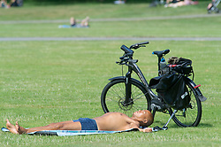 © Licensed to London News Pictures 23/07/2021. Greenwich, UK. Sunbathing in the park. People making the most of a heatwave afternoon in Greenwich park, London before a weekend of torrential rain and thunderstorms spoil the nice weather party. Photo credit:Grant Falvey/LNP