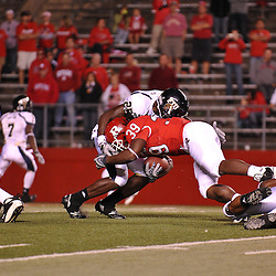 Sep 19, 2009; Piscataway, NJ, USA; Rutgers running back Kordell Young (8) is tackled during the second half of Rutgers' 23-15 victory over Florida International at Rutgers Stadium.